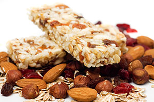 photo of protein bars, nuts, oats, dried fruit