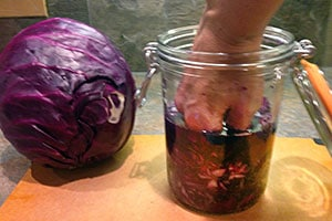Making Sauerkraut: pushing the cabbage down in the jar